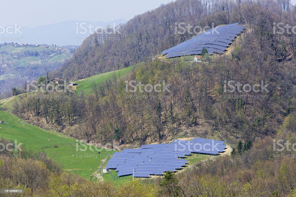 Hill on a country side with solar panels royalty-free stock photo