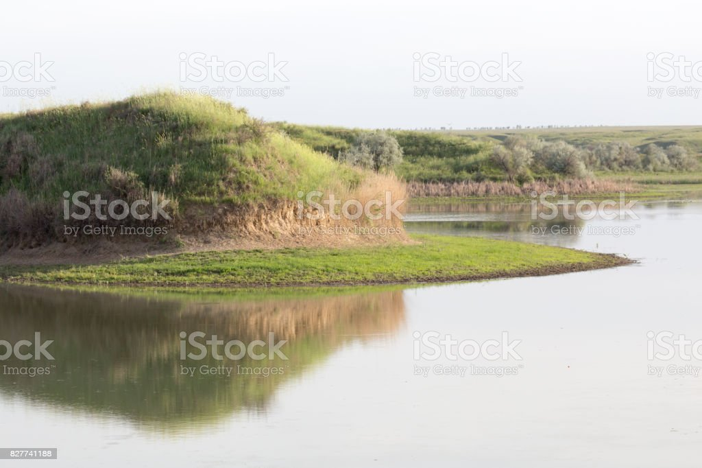 Hill with reflection in the lake stock photo