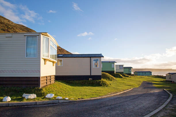 Hillend Caravan and Camping Park in Llangennith, Gower, UK Static caravan holiday homes at Llangennith on the Gower Peninsular in out of season winter. The caravans are closed up until spring. caravan photos stock pictures, royalty-free photos & images