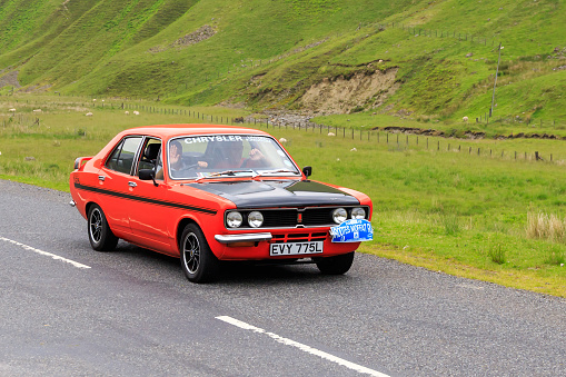 Moffat, Scotland - June  29, 2019: 1972 Hillman Avenger Tiger saloon car in a classic car rally en route towards the town of Moffat, Dumfries and Galloway