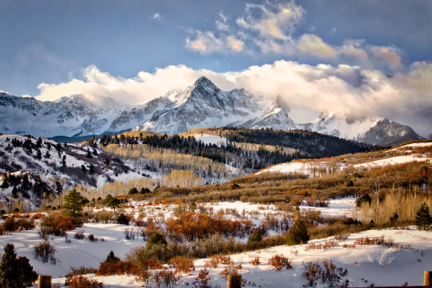 Hills and Valleys Leading to San Juan Mountains Hills and Valleys Leading to San Juan Mountains in Winter in Colorado san juan mountains stock pictures, royalty-free photos & images