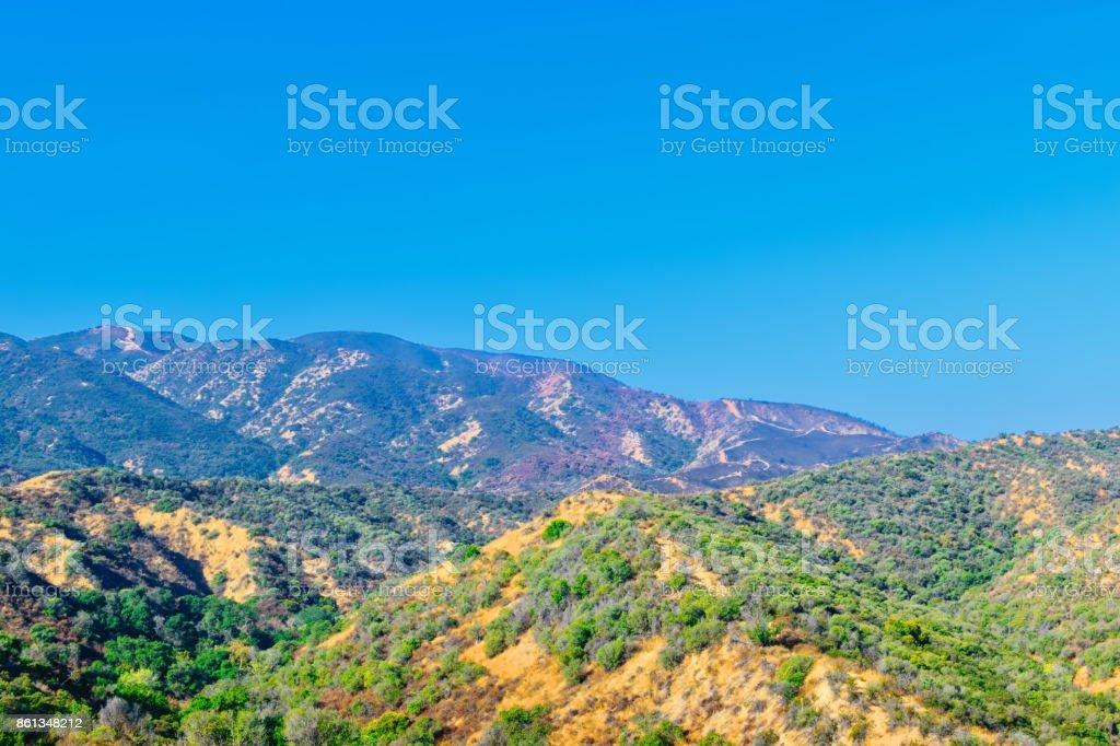 Hillside covered in fire retardant during California fire season stock photo