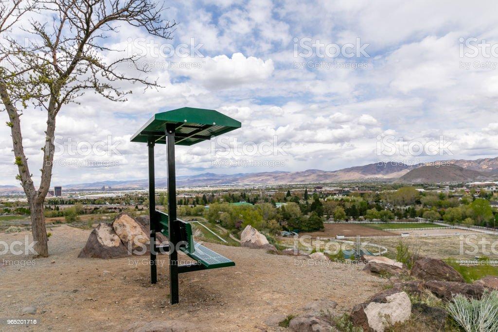 Hilltop bench with a view of Reno, Nevada. zbiór zdjęć royalty-free
