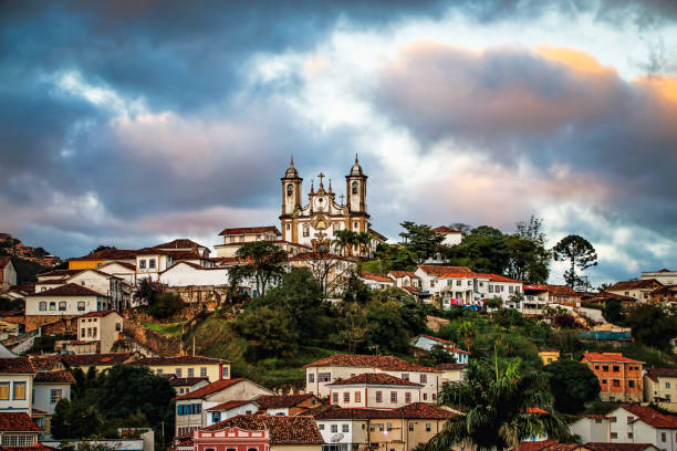 Hilltop Cathedral in Picturesque Colonial Town. Sunset Over Hilltop Colonial Town (Ouro Preto, Minas Gerais, Brazil) with view of Historic Cathedral. southern charm stock pictures, royalty-free photos & images