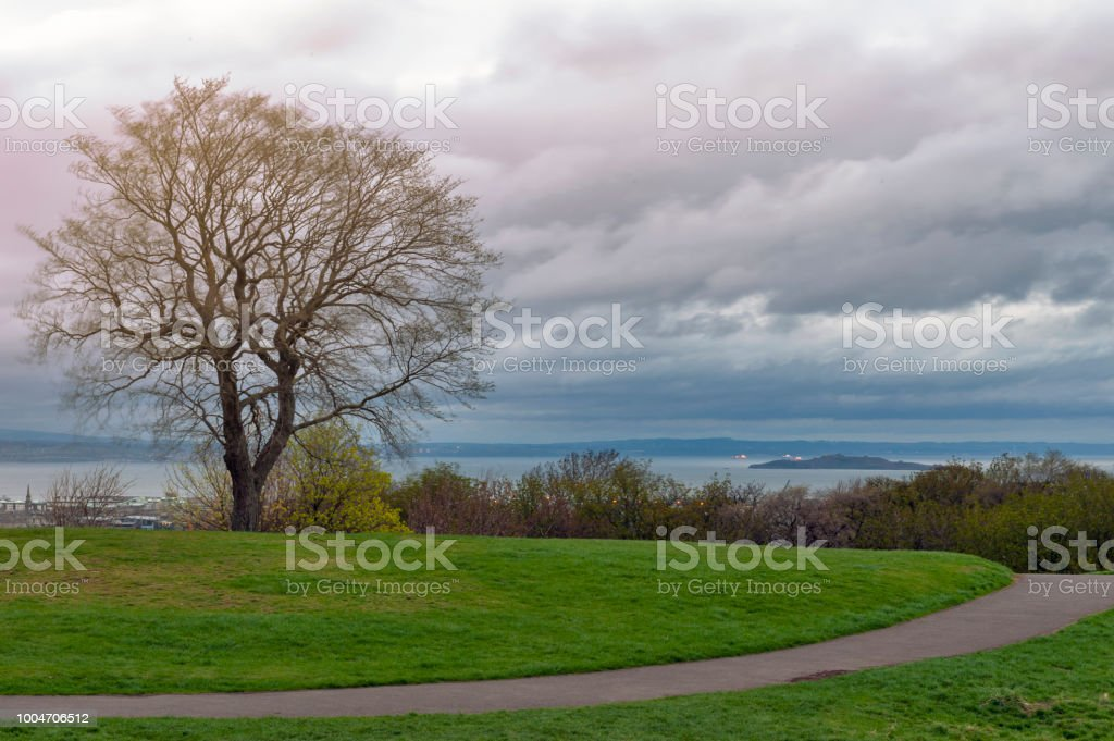 Hilltop Landscape On Calton Hill During Sunset Before The Rain Overlooking The City Of Edinburgh And The North Sea Scotland Uk Stock Photo Download Image Now Istock