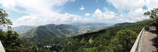 Hilltop Scenic Panoramic of Rural Hong Kong Hilltop scenic panoramic of rural Hong Kong in New Territories, The district of Tai Po and coastline can be seen in the distance. new territories stock pictures, royalty-free photos & images