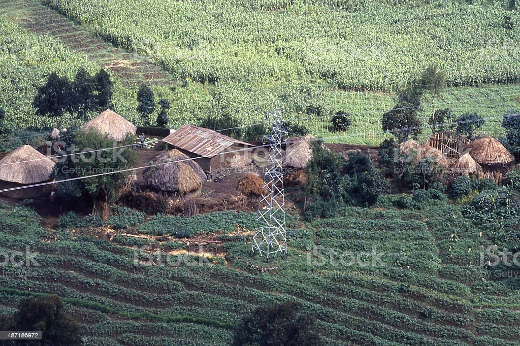 Hilltop traditional village electrical power lines Mudende Rwanda Central Africa stock photo