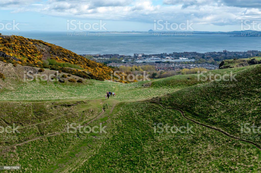 A hillwalking route through grassy slopes up to Arthur's Seat, the highest point in Edinburgh located at Holyrood Park, Scotland, UK stock photo