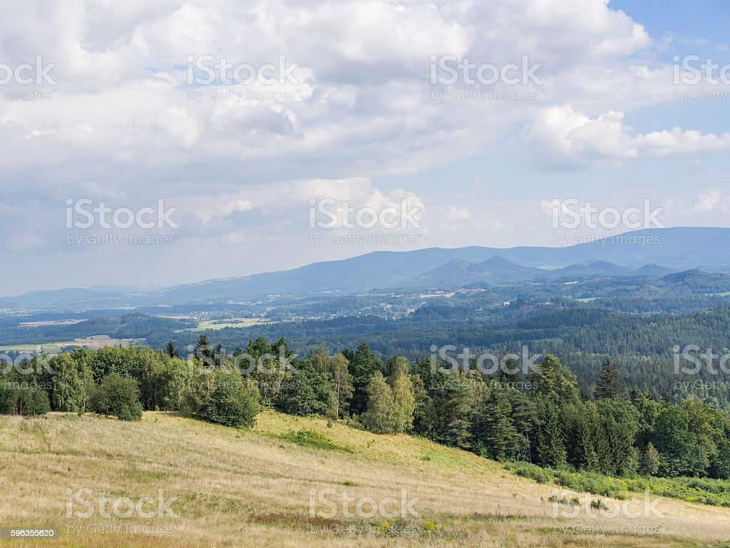 Hilly landscape with field and forest in Jelenia Gora, Poland royalty-free stock photo