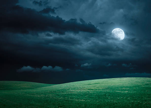 hilly meadow at night with full moon, clouds and grass - moon stock pictures, royalty-free photos & images
