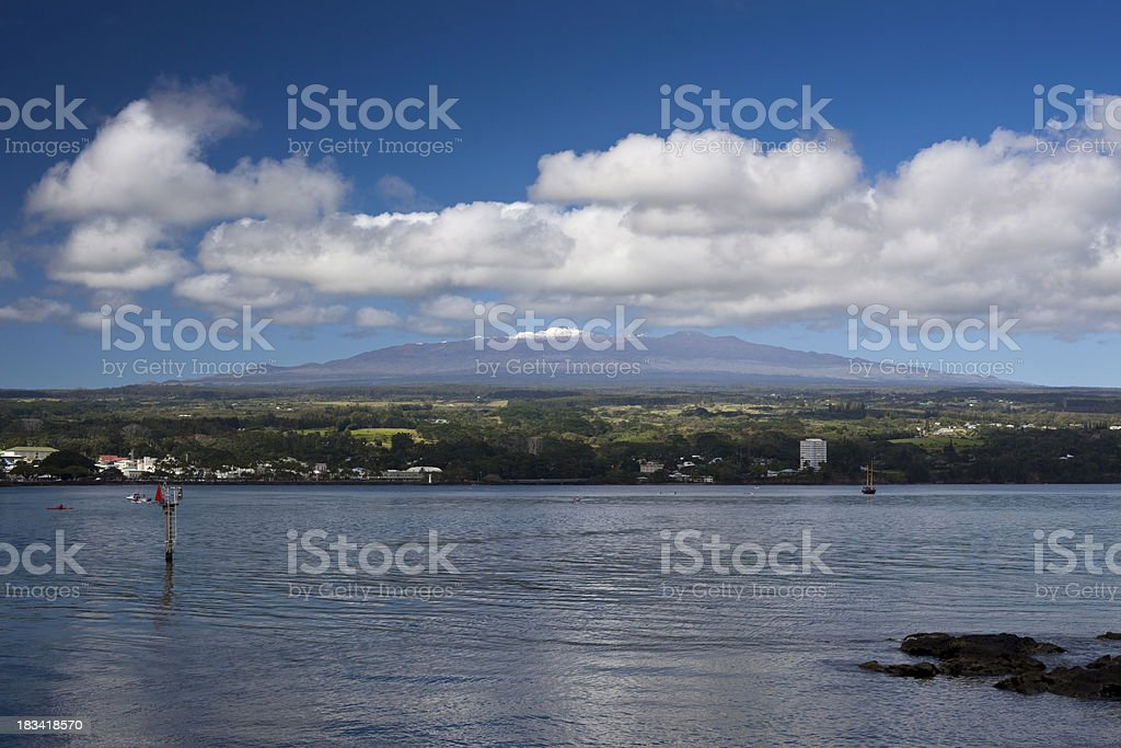 Hilo Bayfront with Snowcapped Mauna Kea in Hawaii stock photo
