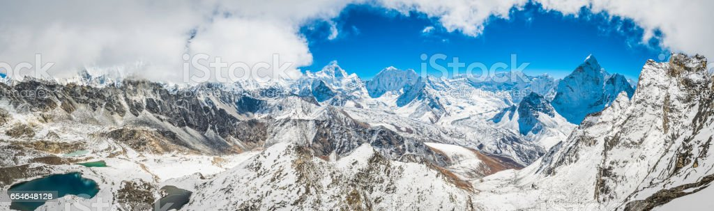 Himalaya mountain kingdom panoramic vista over snow peaks Khumbu Nepal stock photo