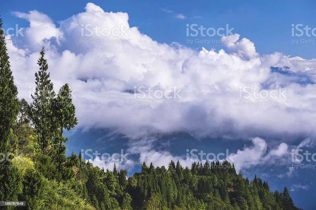 Himalaya mountain peeps above the clouds, Arunachal Pradesh, India. stock photo