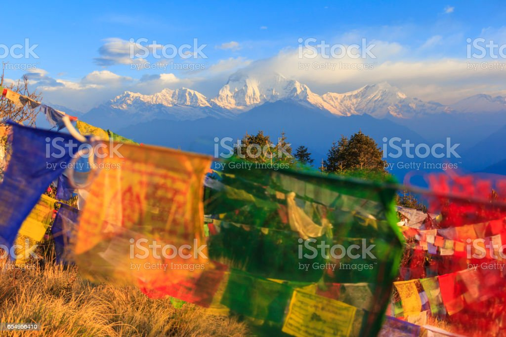 Himalaya mountain range with prayer flags, view from Poonhill, famous trekking destination in Nepal. stock photo