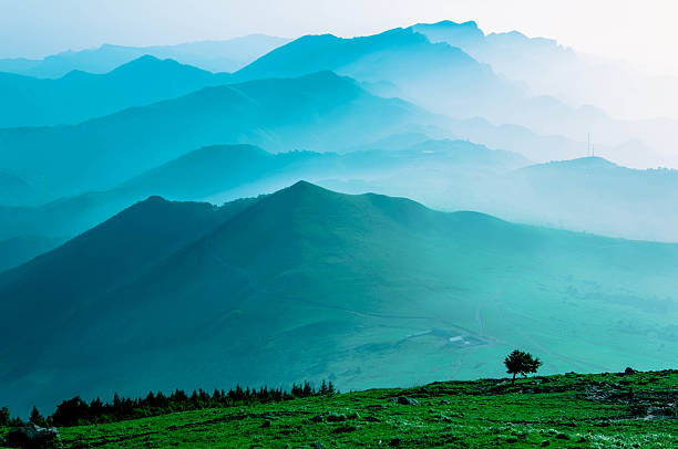 Himalaya Mountains Covered in Mist and Fog stock photo