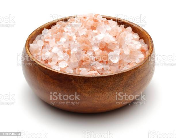 Photo of Himalaya salt in wooden bowl isolated
