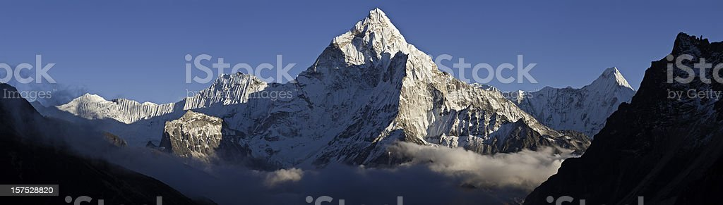 Himalaya snow peaks Nepal Ama Damblam Khumbu cloud mountain panorama royalty-free stock photo
