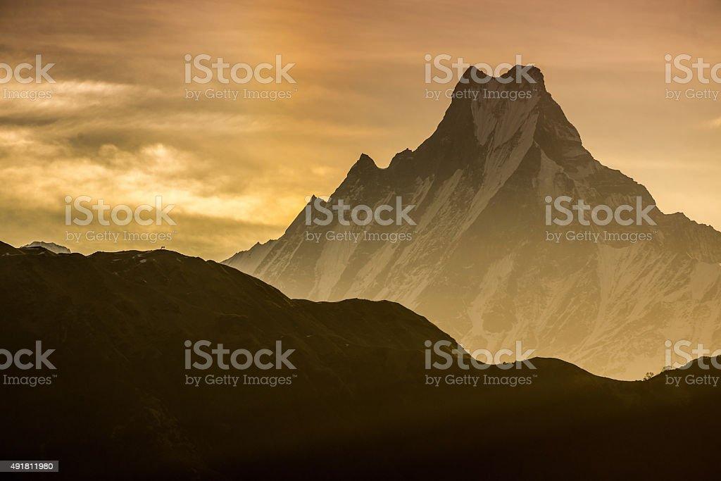 Himalayan mountain peak during sunrise stock photo