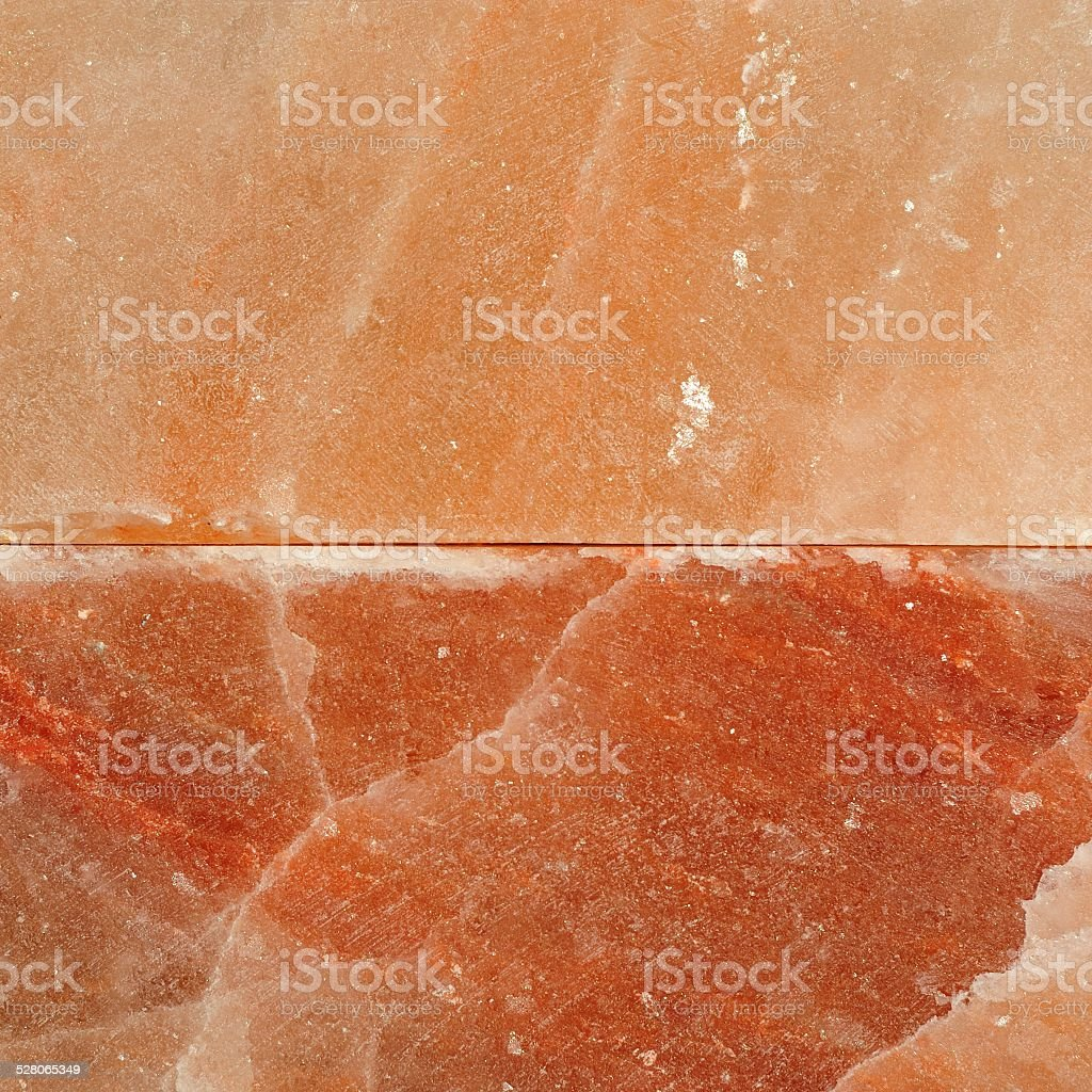 Himalayan pink salt block surface stock photo