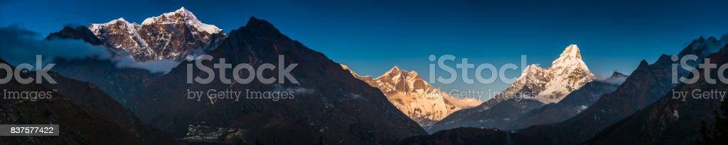 Himalayas alpenglow illuminating snowy mountain peaks Sherpa monastery Khumbu Nepal stock photo