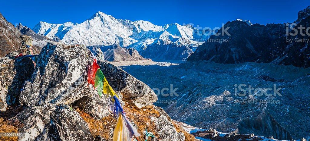 Himalayas Cho Oyu summit overlooking Ngozumpa glacier prayer flags Nepal stock photo