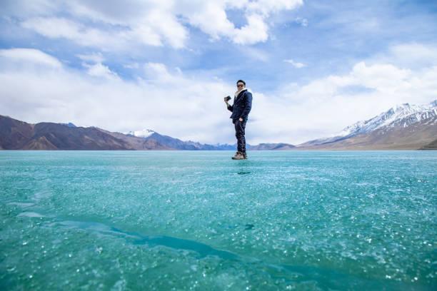 Himalayas mountains and Frozen lake Pangong Tso high stock photo