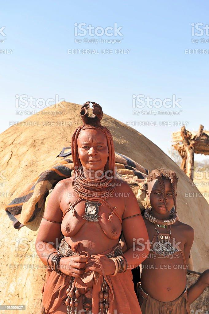 Himba mother and daughter in village near Opuwo,Kaokoveld,Namibia stock photo