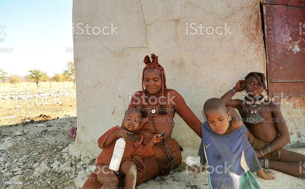 Himba mother  with children in village near Opuwo,Kaokoveld,Namibia stock photo