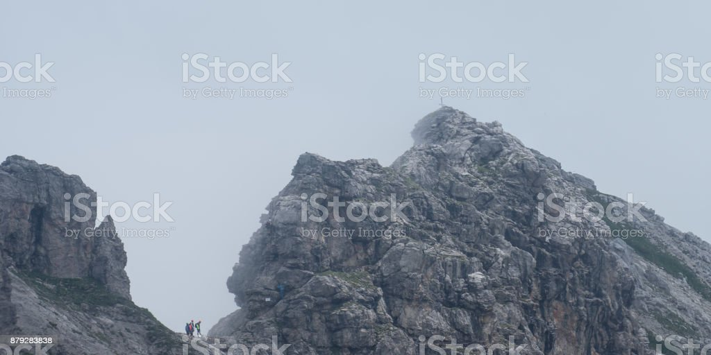 Hindelanger via ferrata with peak Wengenkopf and fog stock photo