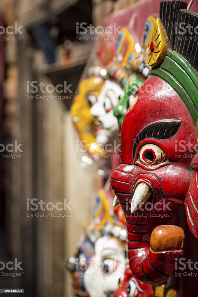 Hindu and Buddhist Wooden Masks in Souvenir Market royalty-free stock photo