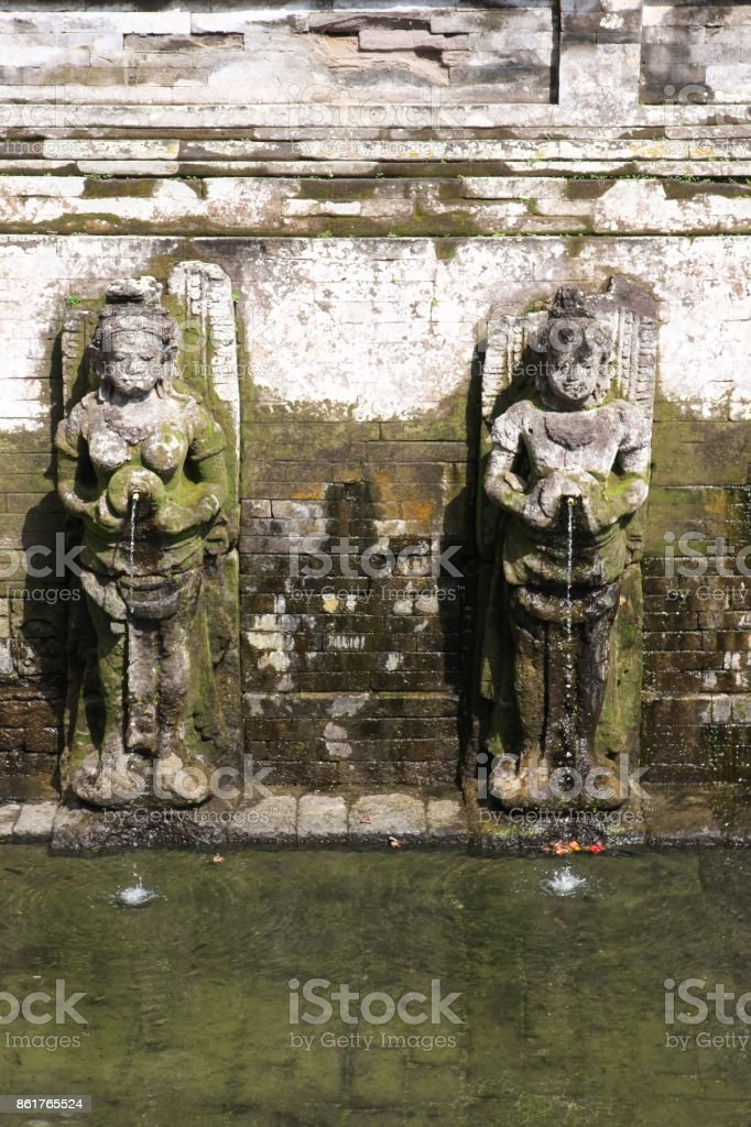 Hindu angles clutching vases at Goa Gajah, Bali stock photo
