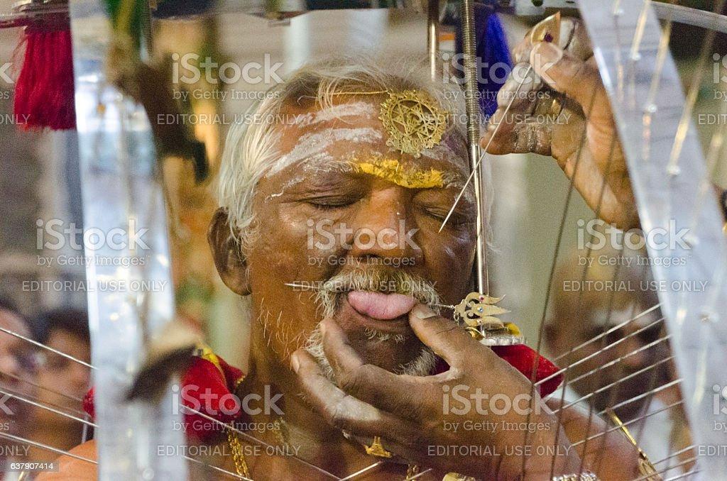 Hindu devotee piercing tongue for Thaipsam stock photo