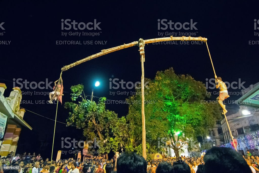 Hindu devotees hanging in air for Charhak festival, for welcoming Bengali new year 1424. stock photo