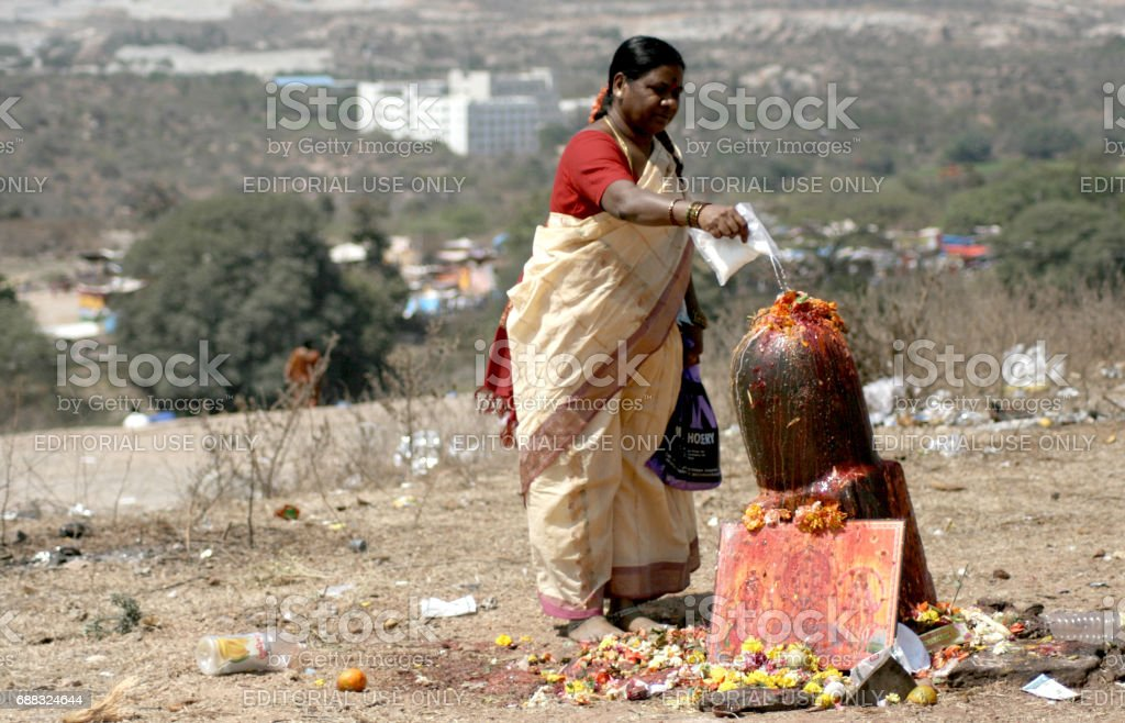 Hindu devotees perform puja to lord siva idol sculpted out of stone on maha siva ratri festivalday stock photo