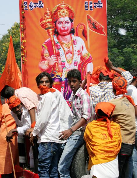 Hindu devotess take a Hanuman Jayanthi Shobha Yatra of Hanuman god ,a devotee of Lord Rama HYDERABAD,INDIA-APRIL 16:Hindu devotess take a Hanuman Jayanthi Shobha Yatra of Hanuman god ,a devotee of Lord Rama in Hyderabad,india on April 16,2014. hanuman stock pictures, royalty-free photos & images