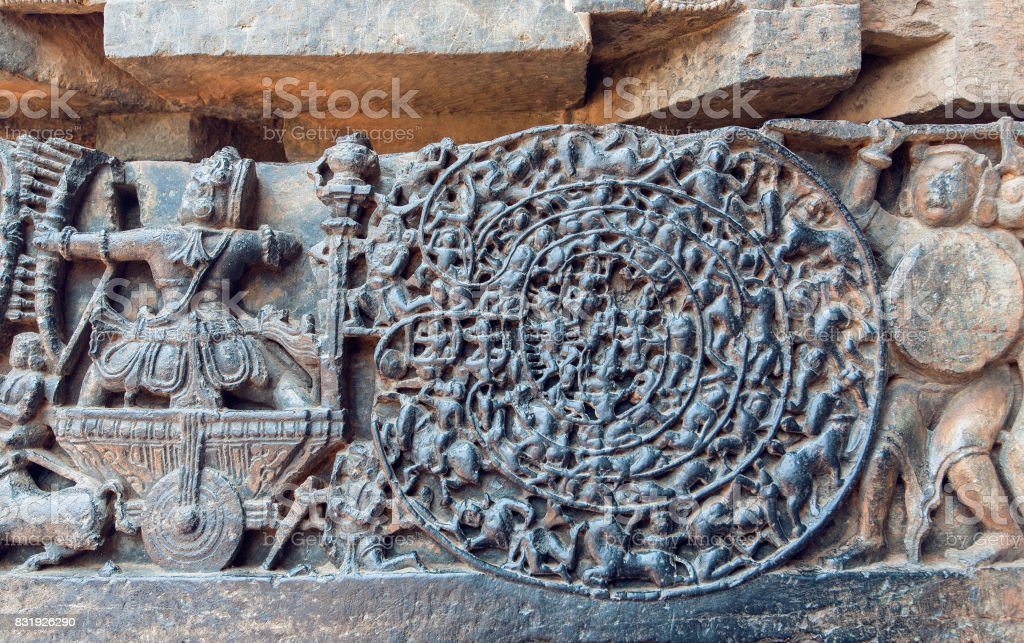 Hindu epic Mahabharata scene on carvings. Story of warrior Abhimanyu entering the Chakravyuha, temple in Halebidu, India stock photo