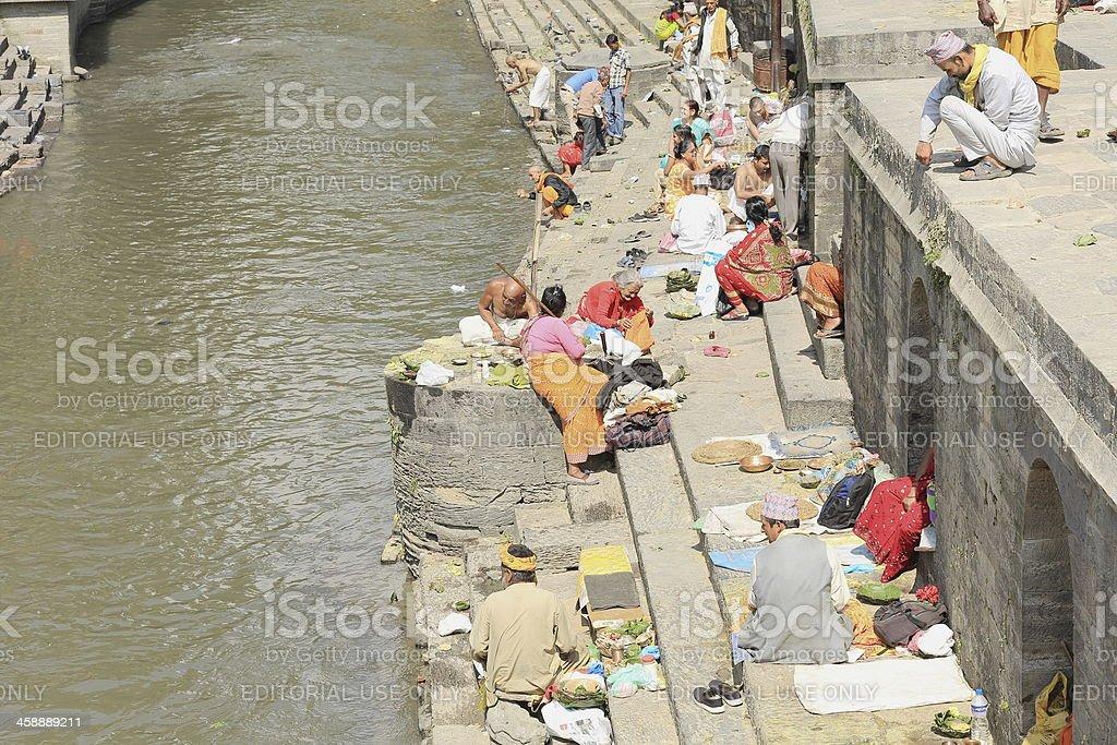 Hindu faithfuls and bhatta priests-Bagmati river-Pashupatinbath temple-Deopatan-Kathmandu-Nepal. 0287 stock photo