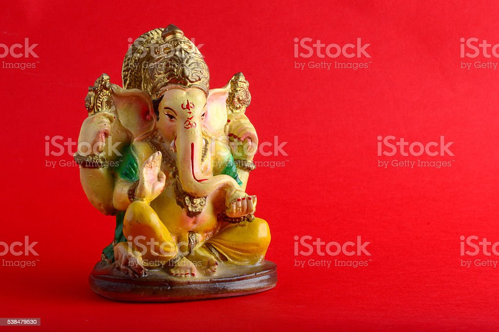 Hindu God Ganesha on red stock photo