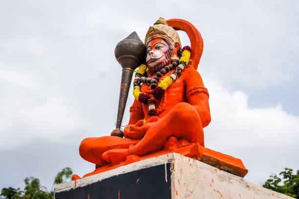 Hindu God Hanuman idol, Huge Statue of Indian lord Hanuman. Indian God Hanuman Huge Statue Background hanuman stock pictures, royalty-free photos & images