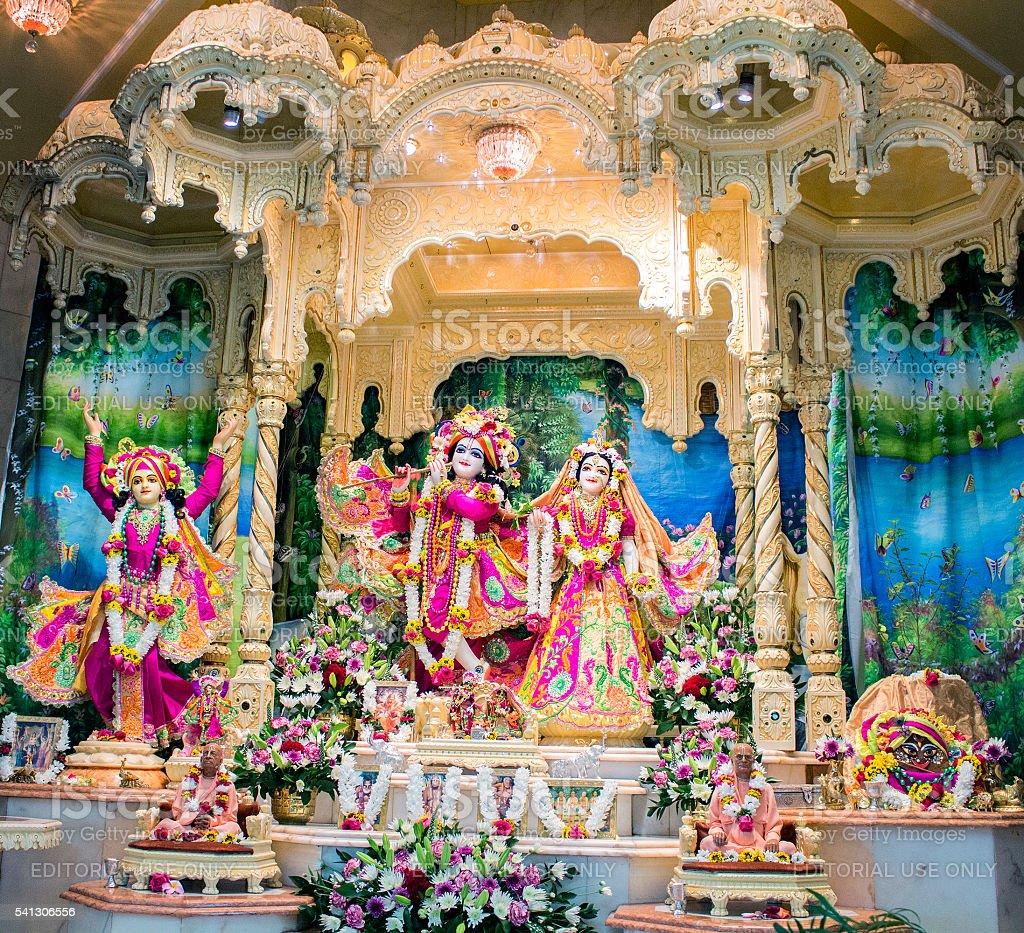 Hindu God Krishna with his wife Radha. Bright colorful sculptura stock photo