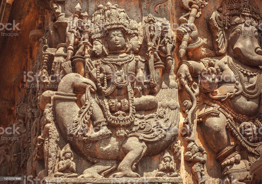 Hindu god of war, Murugan, on facade of Indian temple with friezes...