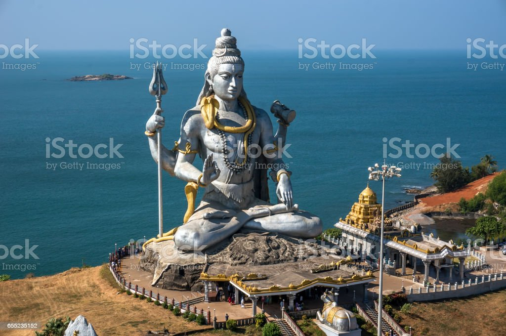 Hindu god statue, lord Shiva sculpture sitting in meditation India, 2011 stock photo