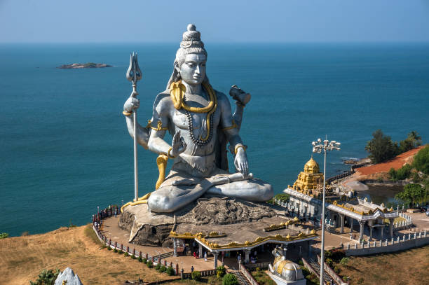 hindu god statue, lord shiva sculpture sitting in meditation india, 2011 - hinduism stock photos and pictures