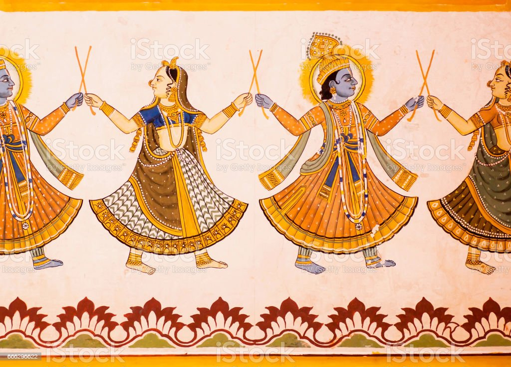 Hindu gods dancing on a fresco with colorful paints on carved wall of 19th century house in India. stock photo