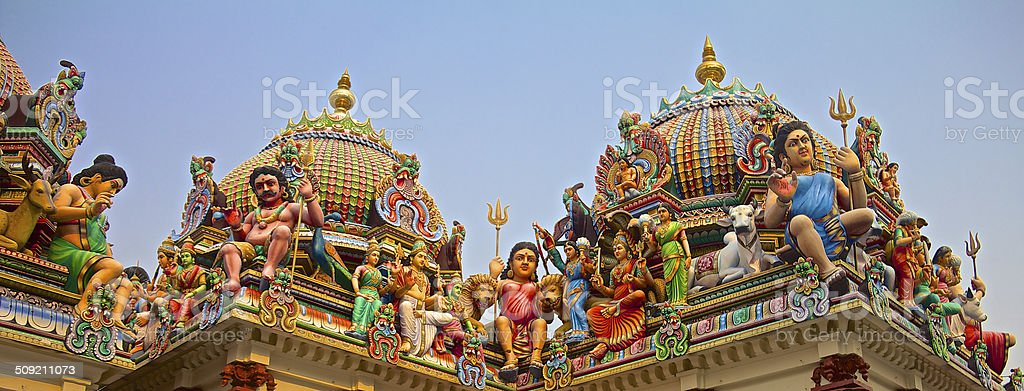 Hindu gods on a temple roof stock photo
