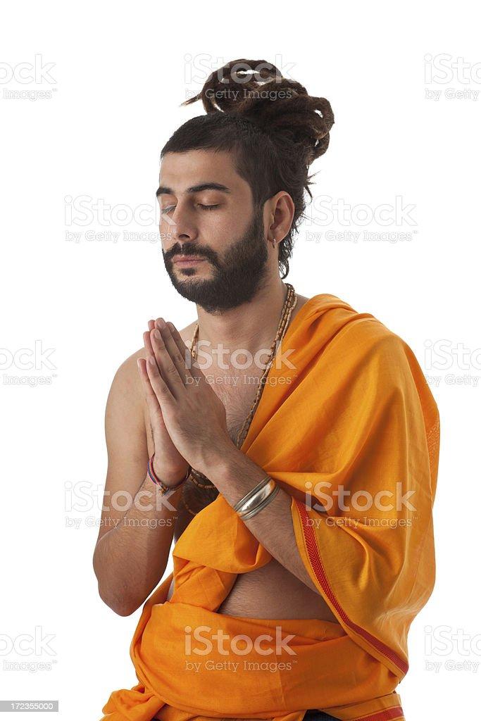 Hindu guru meditating on white background royalty-free stock photo