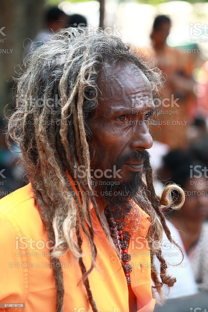 Hindu holy man's side pose stock photo