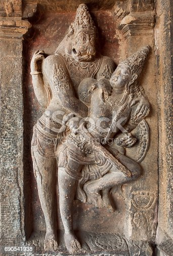 istock Hindu Lord Narasimha killing the evil. Indian rock-cut architecture of the 7th century temple, in town Pattadakal, India 690541938