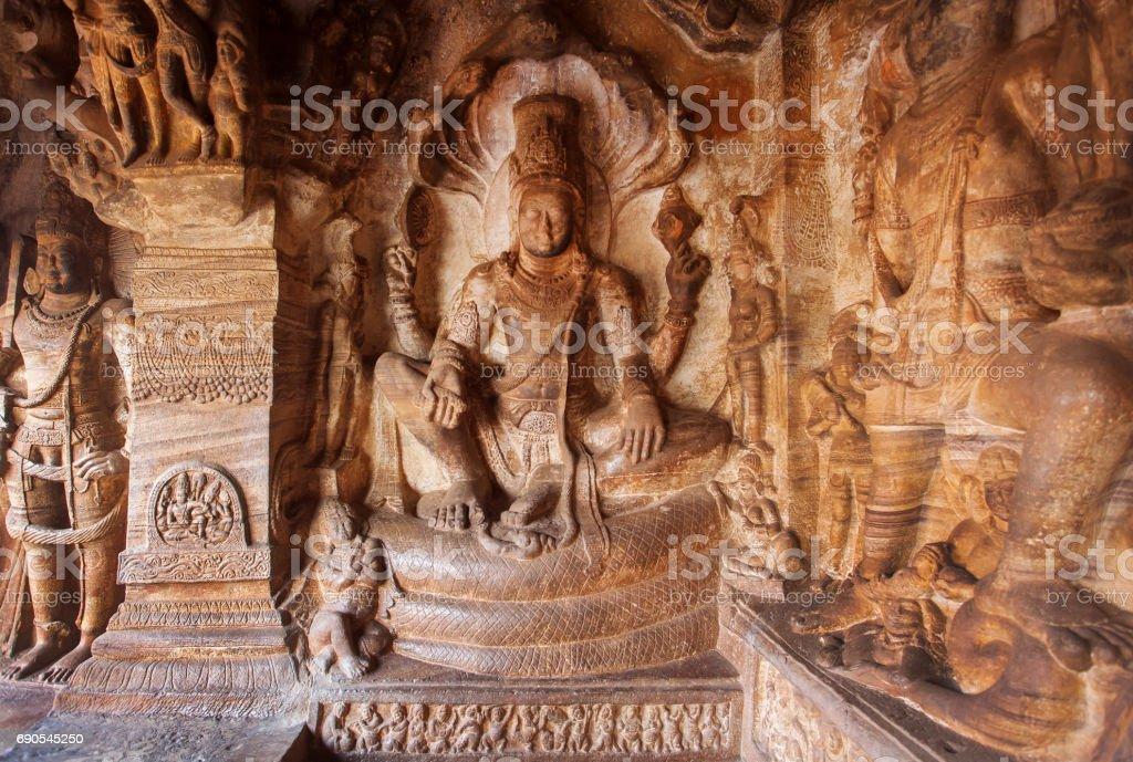 Hindu Lord Vishnu seating on serpent Sesha. 6th century temple in town Badami, India stock photo