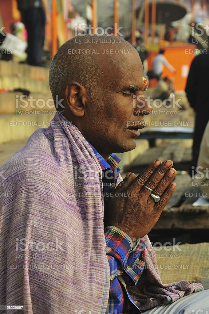 Hindu man praying by the holy Ganges River. royalty-free stock photo